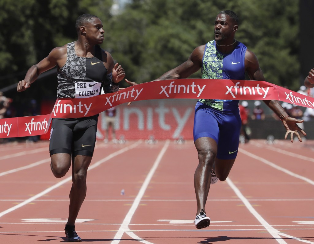 FILE - In this June 30, 2019, file photo, Christian Coleman, left, of the United States, wins the 100-meter race as he looks towards compatriot Justin