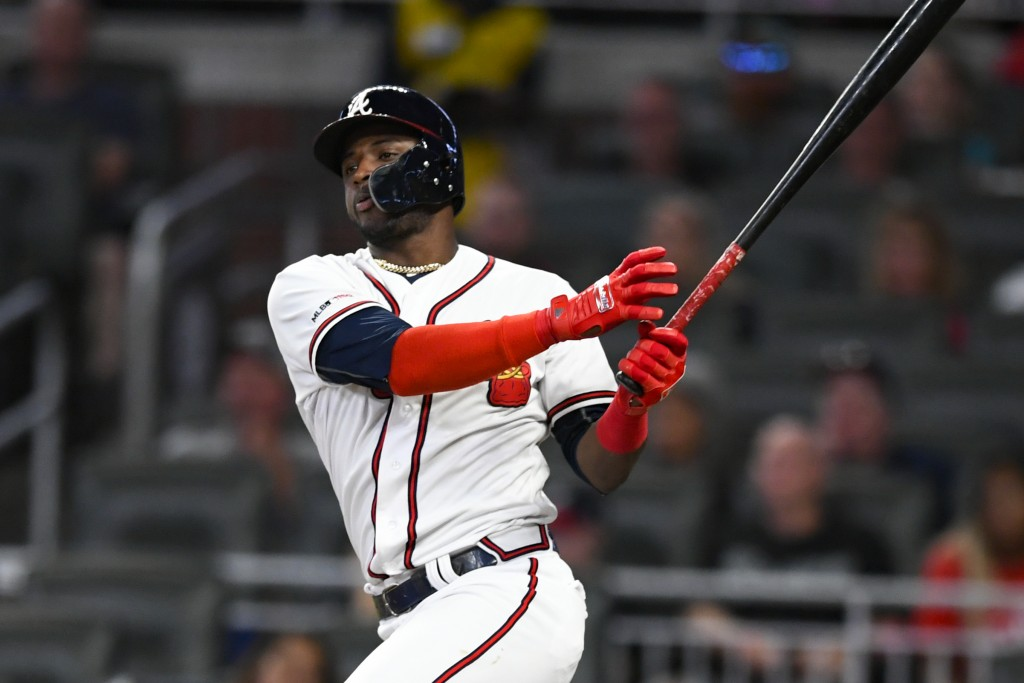 Atlanta Braves' Adeiny Hechavarria watches his line drive double to left field during the second inning of a baseball game against the San Francisco G