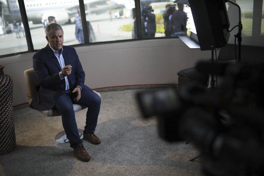Colombia's President Ivan Duque speaks during an interview with The Associated Press at the CATAM air base in Bogota, Colombia, Saturday, Sept. 21, 20...
