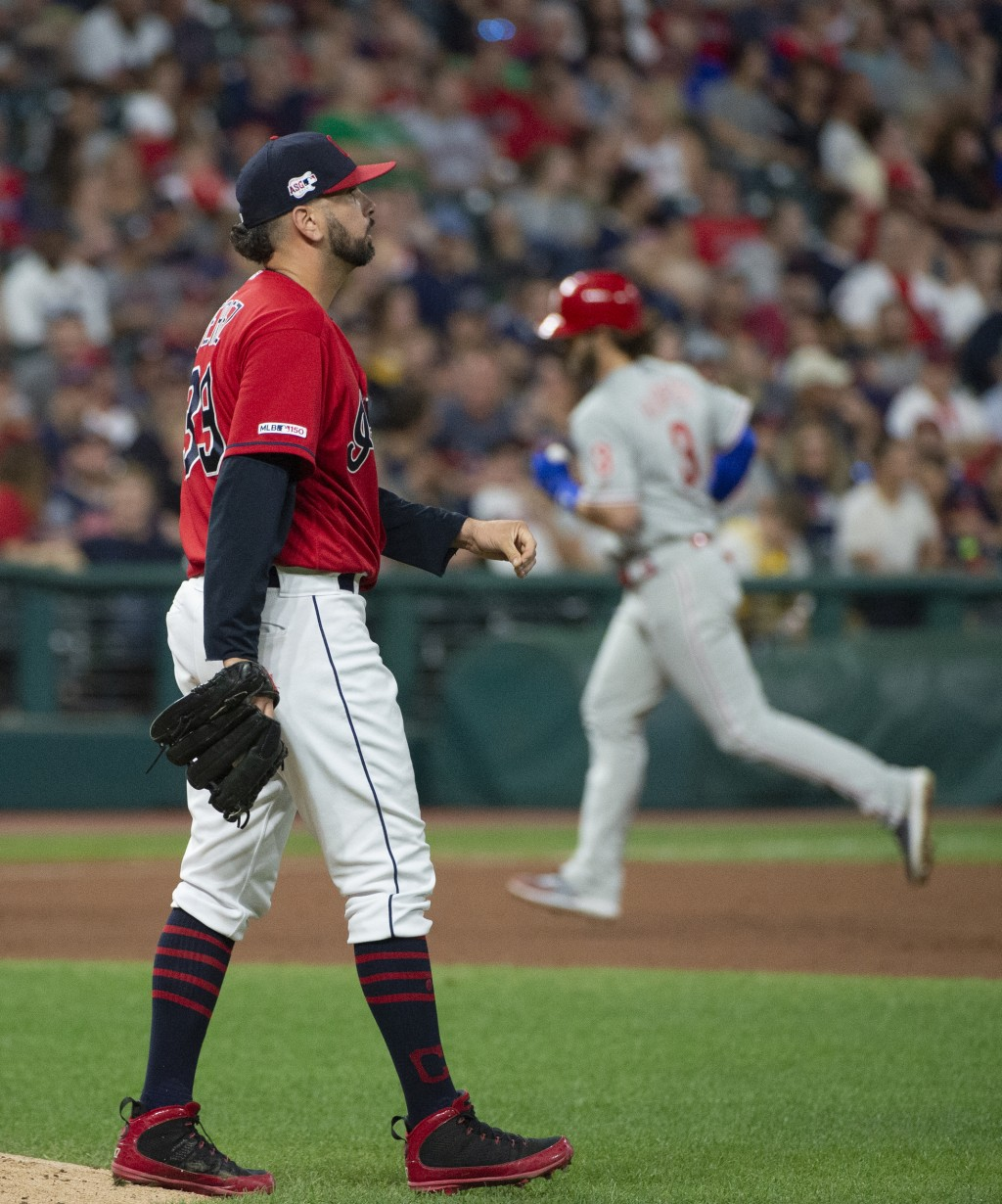 Cleveland Indians relief pitcher Oliver Perez walks off the mound as Philadelphia Phillies' Bryce Harper rounds the bases after hitting a three-run ho...