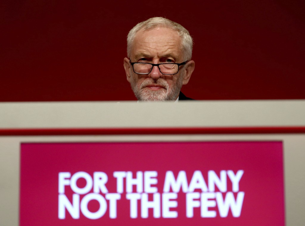 Jeremy Corbyn stands on stage during the Labour Party Conference in Brighton, England, Saturday Sept. 21, 2019. (Gareth Fuller/PA via AP)