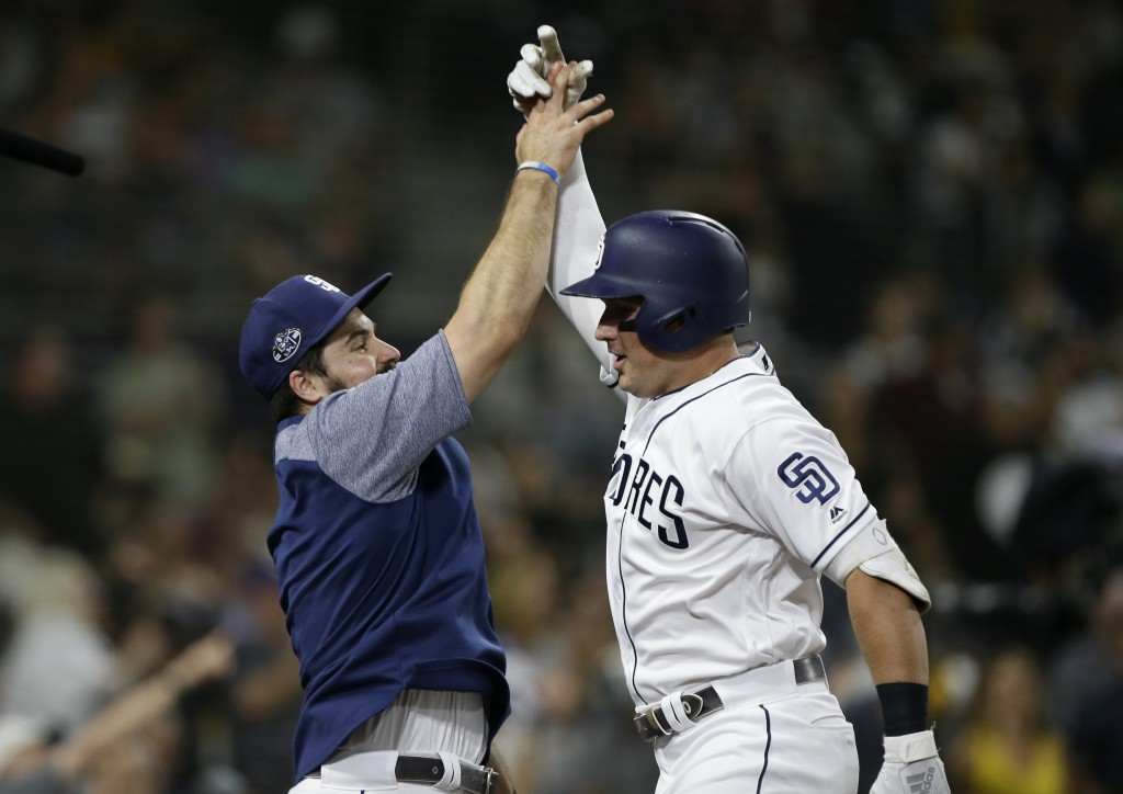 San Diego Padres' Austin Hedges, left, congratulates Hunter Renfroe, right, after Renfroe hit a solo home run, during the fifth inning of a baseball g