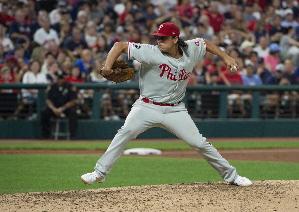 Philadelphia Phillies starting pitcher Jason Vargas delivers to Cleveland Indians' Jordan Luplow during the third inning of a baseball game in Clevela...