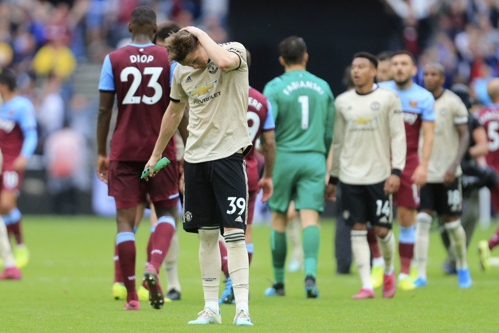 Manchester United's Scott McTominay salutes supporters at at the end of the English Premier League soccer match between West Ham and Manchester United...