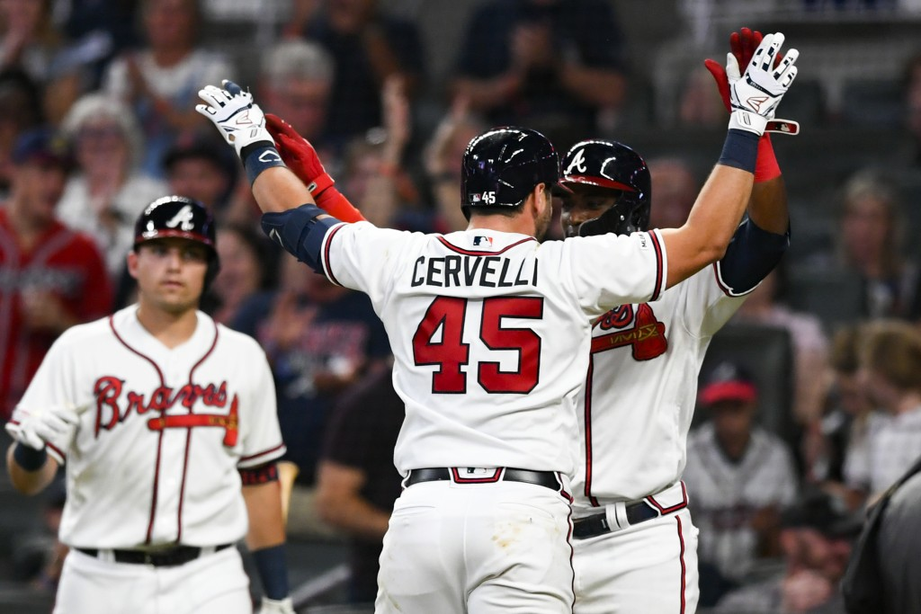 Atlanta Braves' Francisco Cervelli (45) celebrates his two-run home run at home plate with Adeiny Hechavarria during the fifth inning of a baseball ga