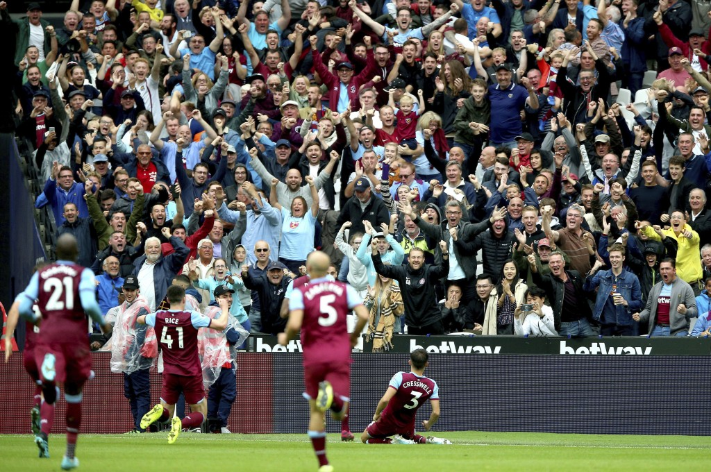 West Ham United's Aaron Cresswell, right, celebrates scoring against Manchester United during the English Premier League soccer match at London Stadiu...