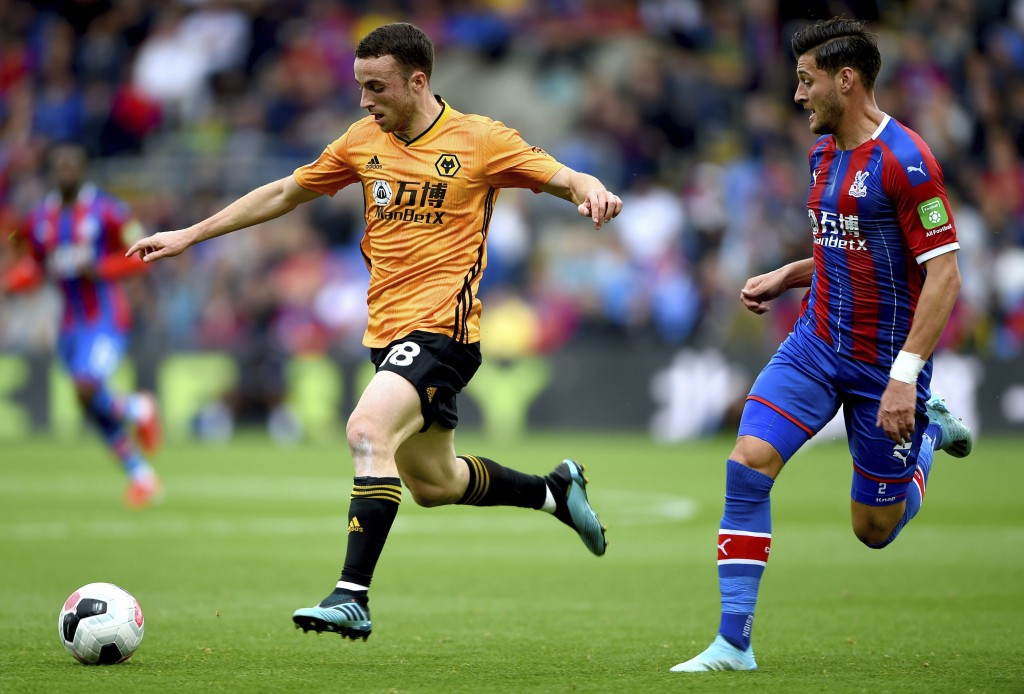 Wolverhampton Wanderers' Diogo Jota, left, and Crystal Palace's Joel Ward battle for the ball during their English Premier League match at Selhurst Pa...