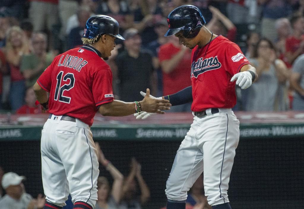 Cleveland Indians' Francisco Lindor congratulates Oscar Mercado for hitting a two-run home run off Philadelphia Phillies starting pitcher Jason Vargas