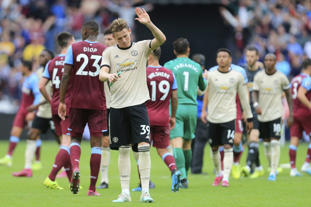 Manchester United's Scott McTominay salutes supporters at at the end of the English Premier League soccer match between West Ham and Manchester United