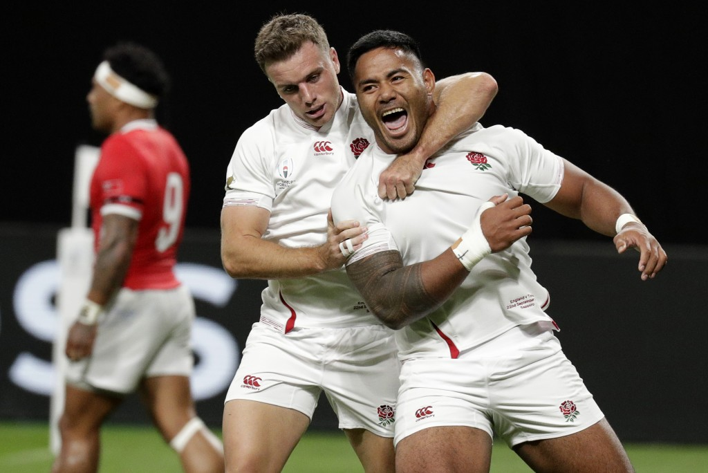 England's Manu Tuilagi, right, is congratulated by teammate George Ford after scoring his second try during the Rugby World Cup Pool C game at Sapporo...