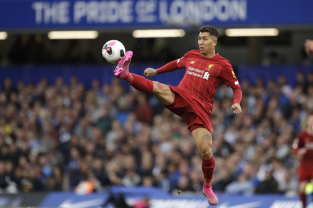 Liverpool's Roberto Firmino reaches for the ball during the British premier League soccer match between Chelsea and Liverpool, at the Stamford Bridge ...