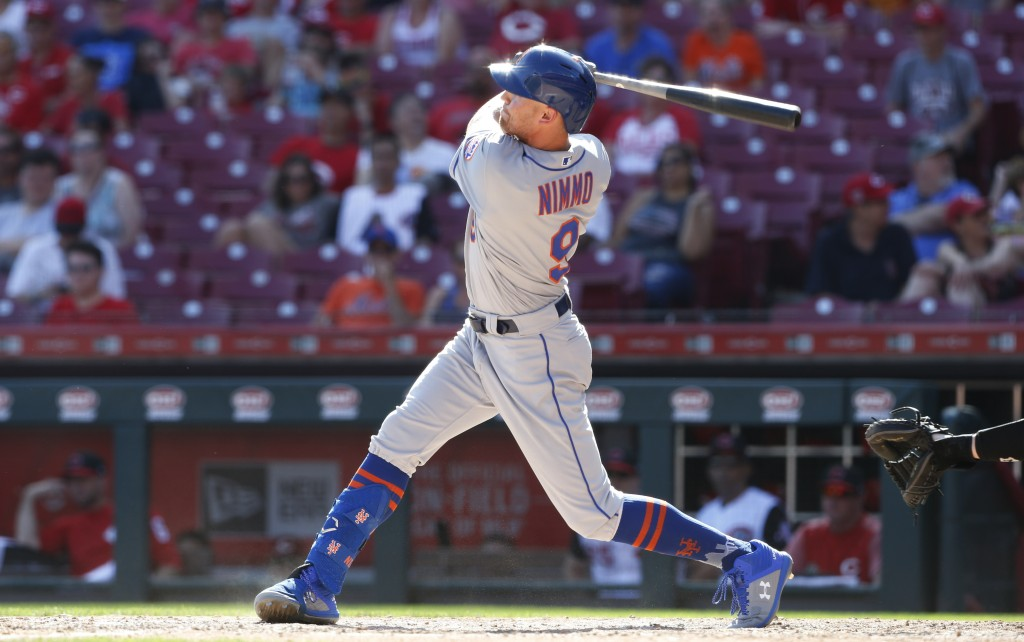 New York Mets' Brandon Nimmo (9) knocks a solo home run off Cincinnati Reds relief pitcher Sal Romano during the ninth inning of a baseball game, Sund