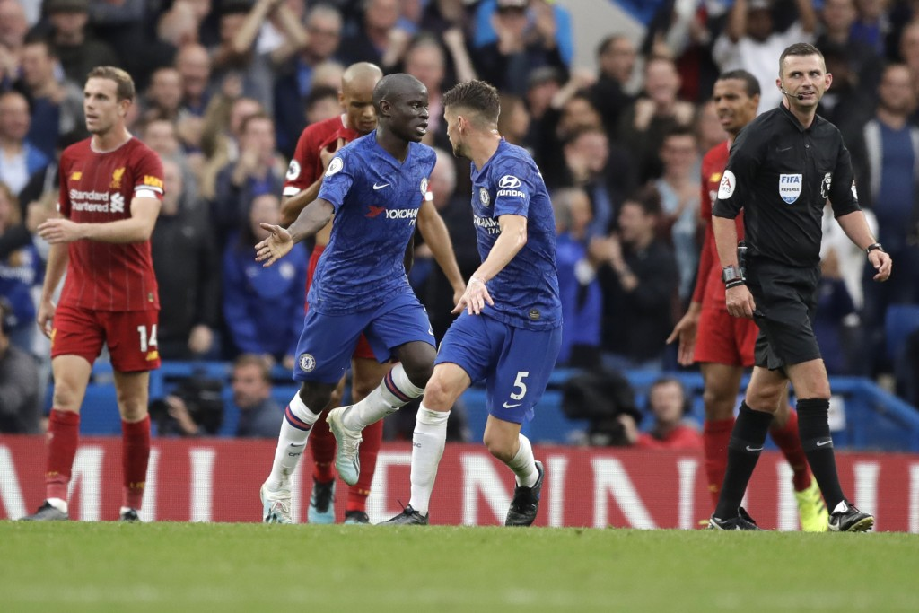 Chelsea's N'Golo Kante, center, celebrates after scoring his side's opening goal during the British premier League soccer match between Chelsea and Li...