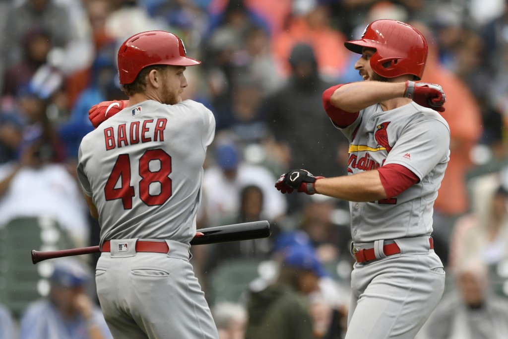 St. Louis Cardinals' Paul DeJong right, celebrates with teammate Harrison Bader (48) after hitting a solo home run during the third inning of a baseba...