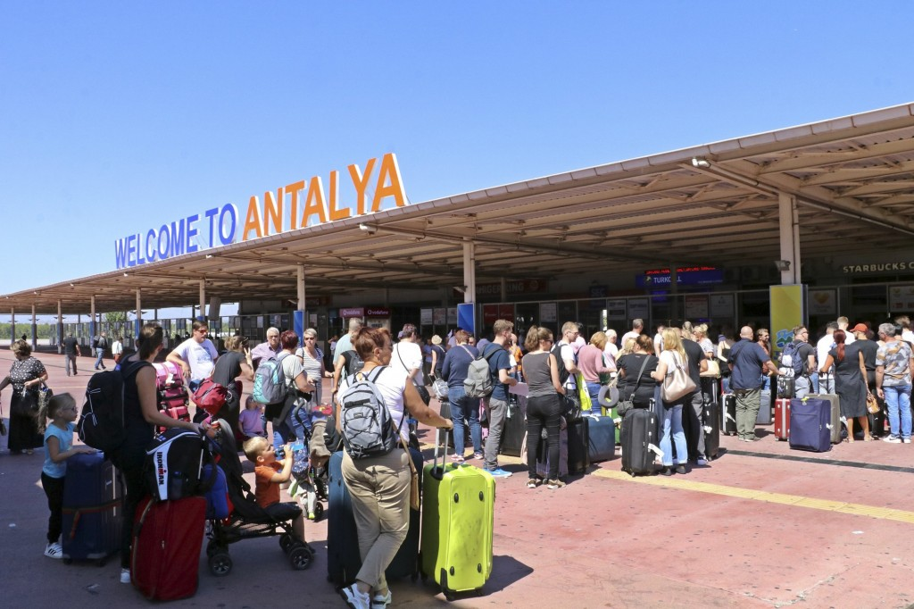 British passengers with Thomas Cook wait in long queue at Antalya airport in Antalya, Turkey, Monday Sept. 23, 2019. Hundreds of thousands of travelle...