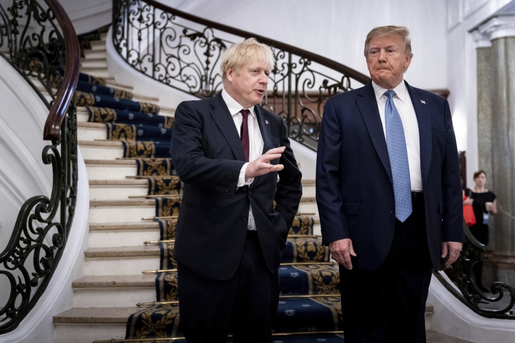 FILE - In this Aug. 25, 2019, file photo, President Donald Trump and Britain's Prime Minister Boris Johnson, left, speak to the media before a working...