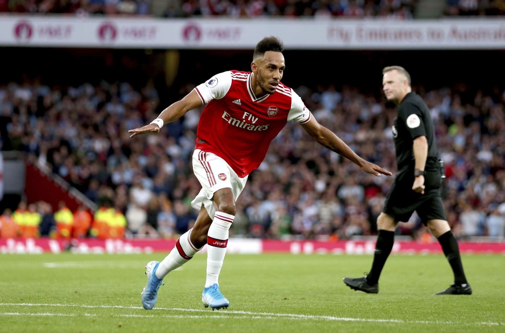 Arsenal's Pierre-Emerick Aubameyang celebrates scoring against Aston Villa during the English Premier League soccer match at the Emirates Stadium, Lon...