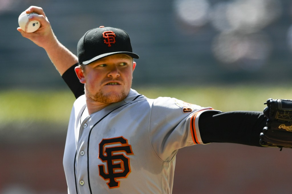 San Francisco Giants' Logan Webb pitches against the Atlanta Braves during the first inning of a baseball game Sunday, Sept. 22, 2019, in Atlanta. (AP...