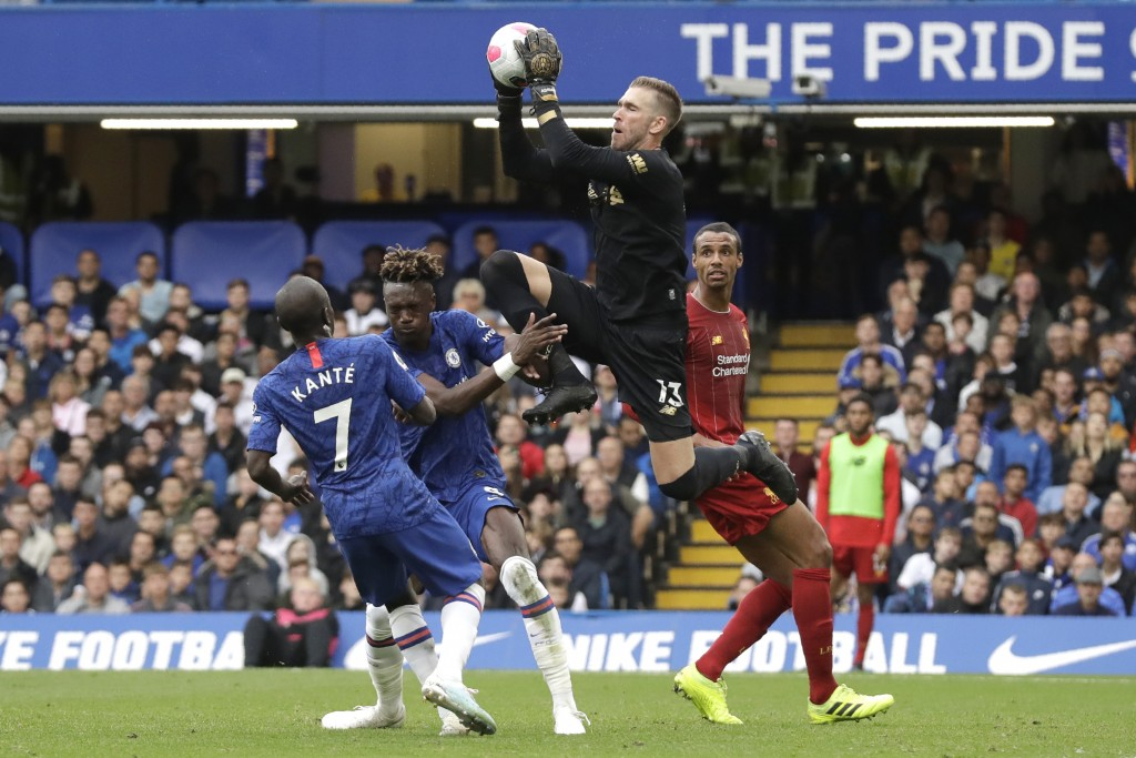 Liverpool goalkeeper Adrian grabs the ball during the British premier League soccer match between Chelsea and Liverpool, at the Stamford Bridge Stadiu...