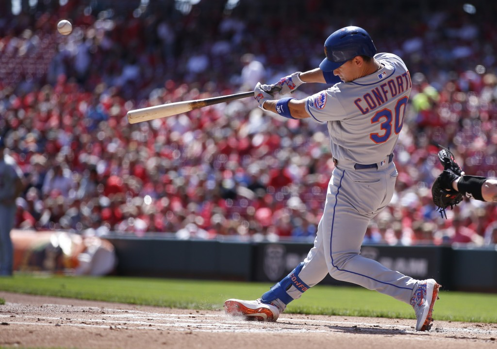 New York Mets' Michael Conforto hits a three-run home run off Cincinnati Reds starting pitcher Trevor Bauer during the first inning of a baseball game