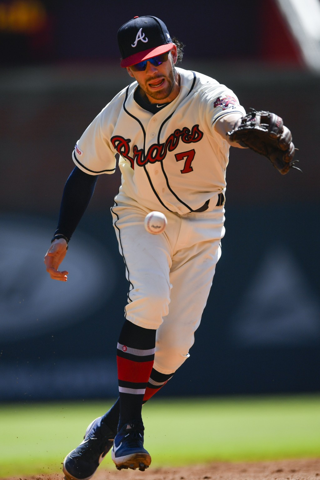 Atlanta Braves shortstop Dansby Swanson (7) makes an error as he bobbles a line drive hit by San Francisco Giants' Kevin Pillar during the sixth innin...