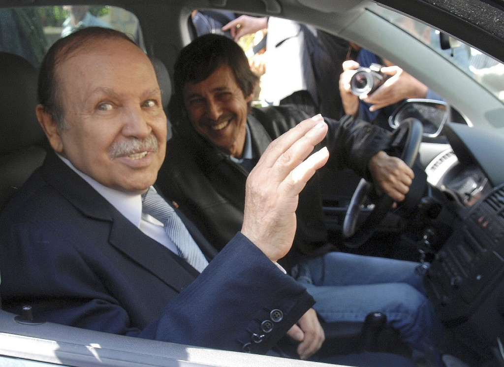 FILE - This Friday April 10, 2009 file photo shows Algerian President Abdelaziz Bouteflika, left, and his brother Said Bouteflika arrives at his campa...