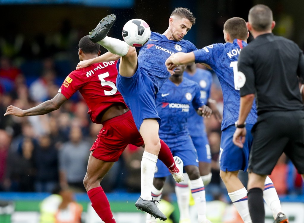 Chelsea's Jorginho goes for the ball during the British Premier League soccer match between Chelsea and Liverpool, at the Stamford Bridge Stadium, Lon...