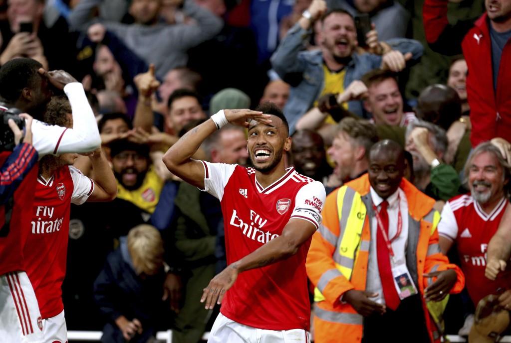 Arsenal's Pierre-Emerick Aubameyang celebrates scoring against Aston Villa during the English Premier League soccer match at the Emirates Stadium, Lon