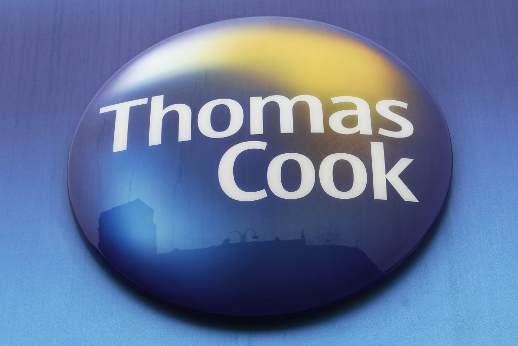 FILE - In this Tuesday, Nov. 22, 2011 file photo, a sign of Thomas Cook travel agent is seen at a branch in north London. More than 600,000 vacationer