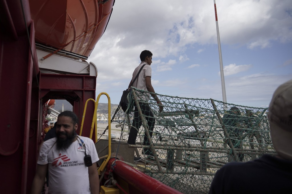 A migrant walks off the Ocean Viking ship docked at the port of Messina, Italy, Tuesday, Sept. 24, 2019. He was among 182 people aboard the Ocean Viki...