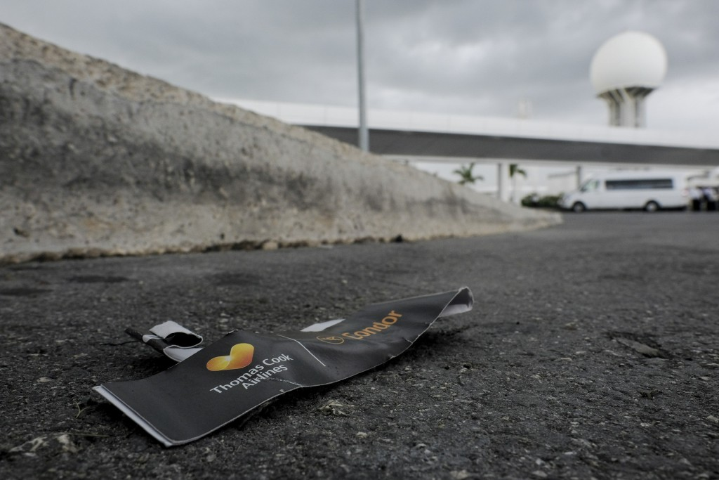 A Thomas Cook luggage tag lays discarded in the street, outside the Cancun airport in Mexico, Monday, Sept. 23, 2019. British tour company Thomas Cook...