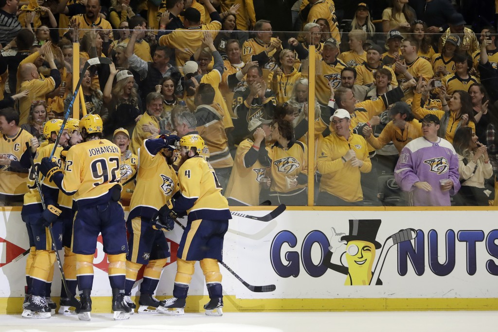 FILE - In this April 29, 2018, file photo, Nashville Predators fans celebrate along with players after the Predators scored a goal against the Winnipe...