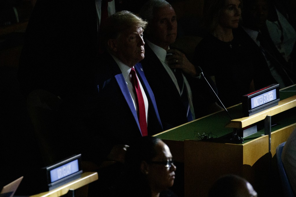 President Donald Trump listens during the United Nations Climate Action Summit during the General Assembly, Monday, Sept. 23, 2019, in New York. (AP P...