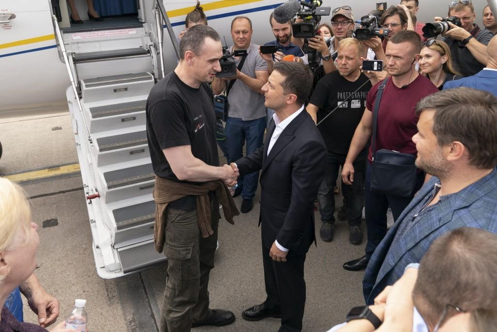 FILE - In this file photo taken on Saturday, Sept. 7, 2019, Ukraine's President Volodymyr Zelenskiy, right, greets Ukrainian prisoner filmmaker Oleg S...