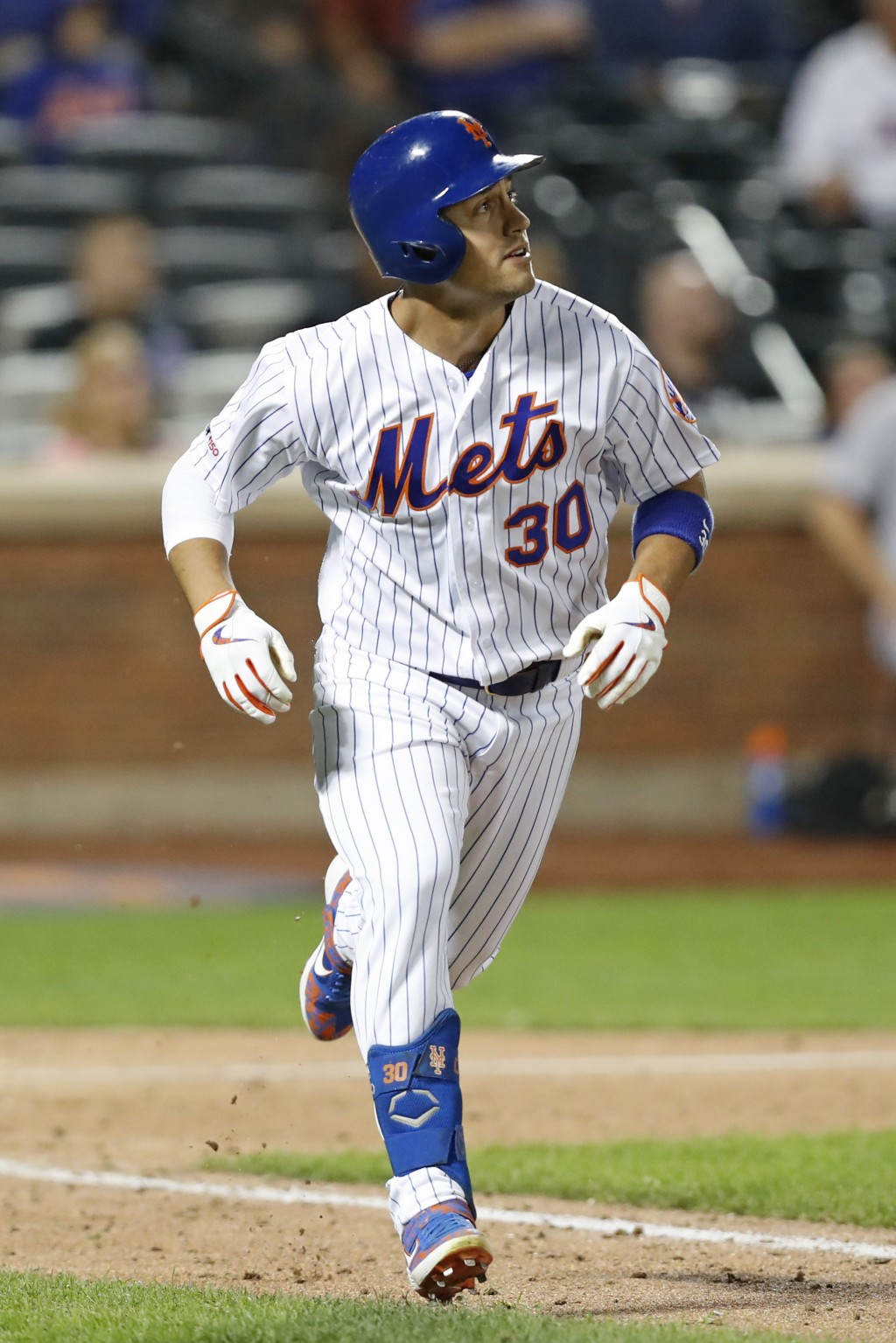 New York Mets' Michael Conforto watches his two-run home run in the seventh inning of the team's baseball game against the Miami Marlins, Tuesday, Sep...