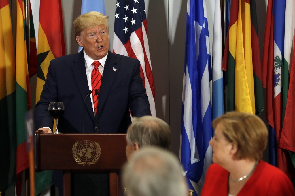 President Donald Trump speaks before giving a toast and participates in a luncheon hosted by United Nations Secretary General Antonio Guterres, center...