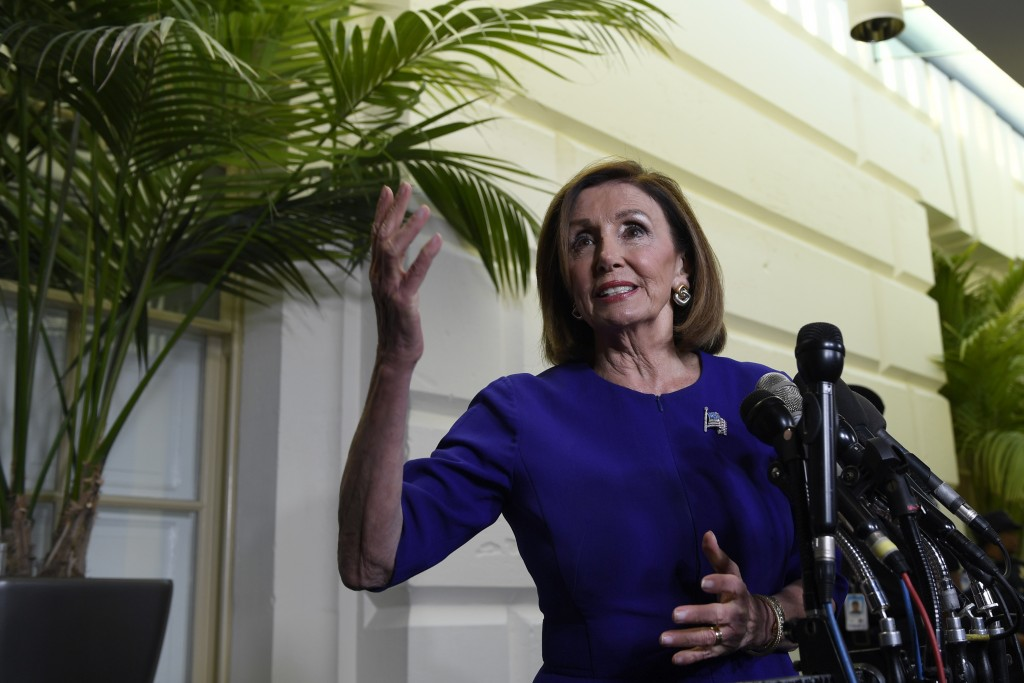 House Speaker Nancy Pelosi of Calif., stops to talks with reporters following a meeting with her caucus on Capitol Hill in Washington, Tuesday, Sept. ...