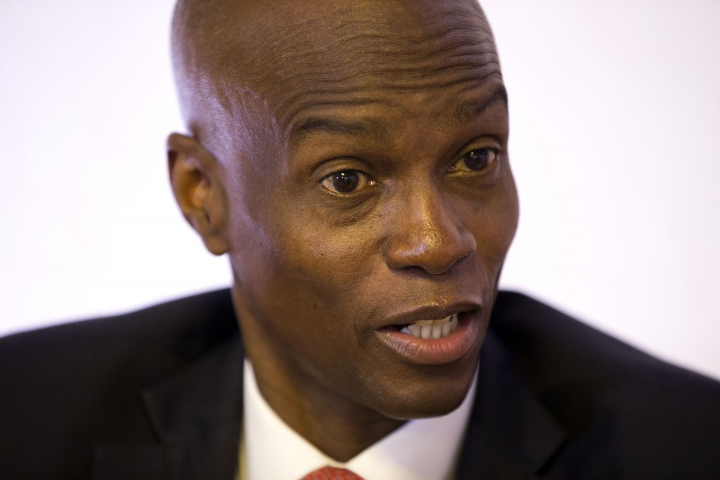 FILE - In this Aug. 28, 2019 file photo, Haiti's President Jovenel Moise speaks during an interview in his office in Port-au-Prince, Haiti. Moise is u...