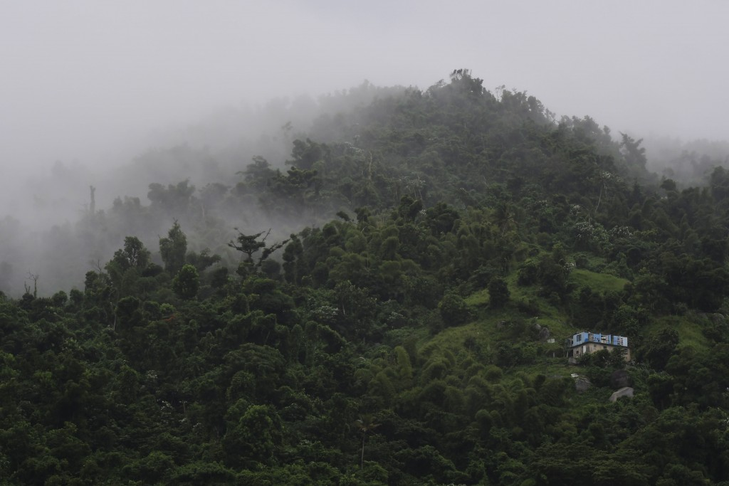 A house without a roof is surrounded by clouds on a mountain in Yabucoa, Puerto Rico, Tuesday, Sept. 24, 2019. Tropical Storm Karen regained strength ...