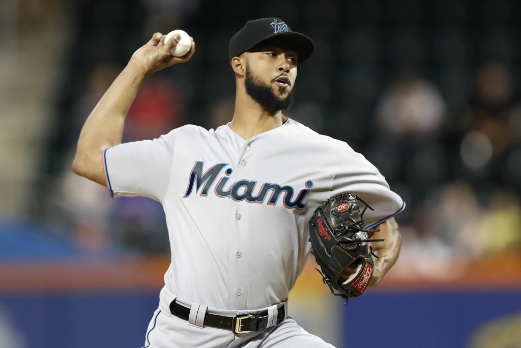 Miami Marlins starting pitcher Sandy Alcantara winds up during the first inning of the team's baseball game against the New York Mets, Tuesday, Sept. ...