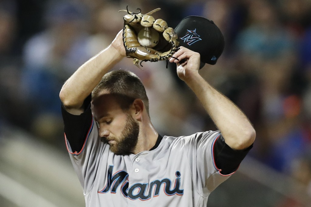 Miami Marlins relief pitcher Josh Smith reacts after hitting New York Mets' Jeff McNeil with a pitch during the sixth inning of a baseball game Wednes...