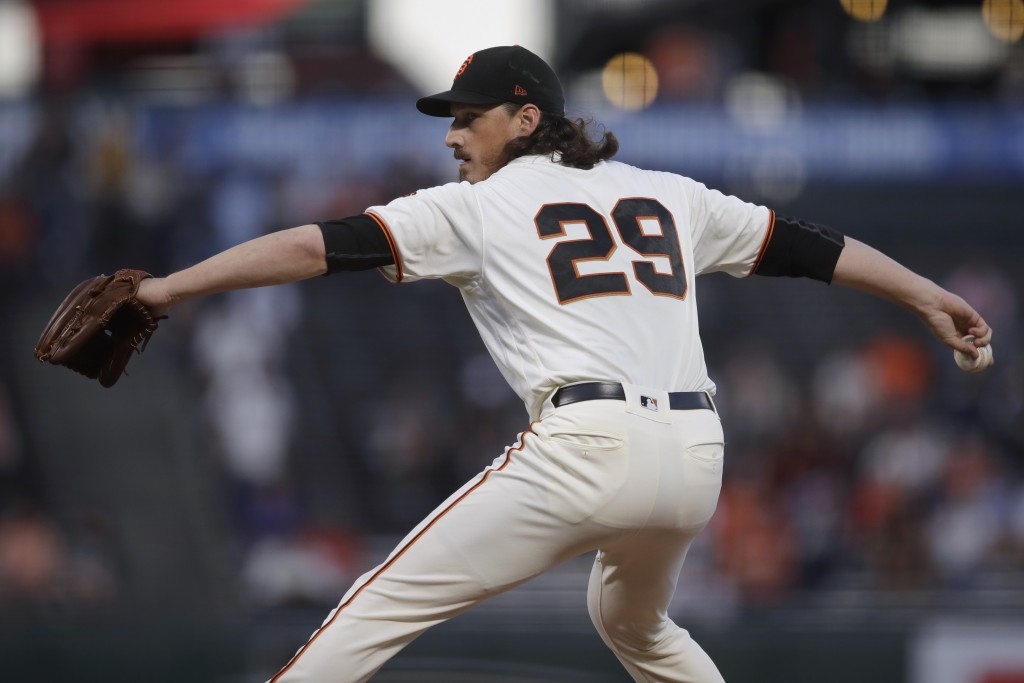 San Francisco Giants pitcher Jeff Samardzija works against the Colorado Rockies during the first inning of a baseball game Wednesday, Sept. 25, 2019, ...
