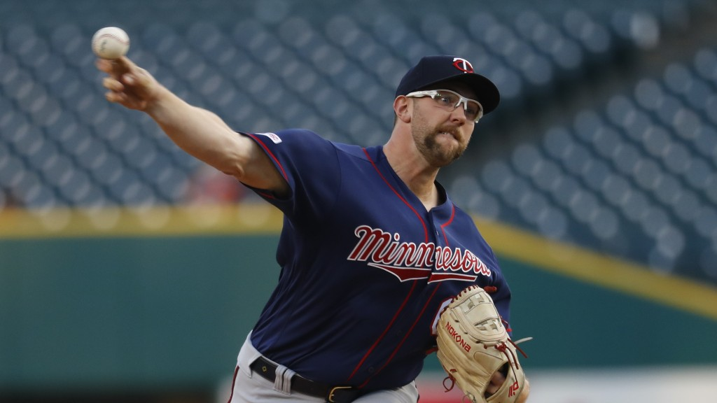 Minnesota Twins pitcher Randy Dobnak throws against the Detroit Tigers in the first inning of a baseball game in Detroit, Wednesday, Sept. 25, 2019. (