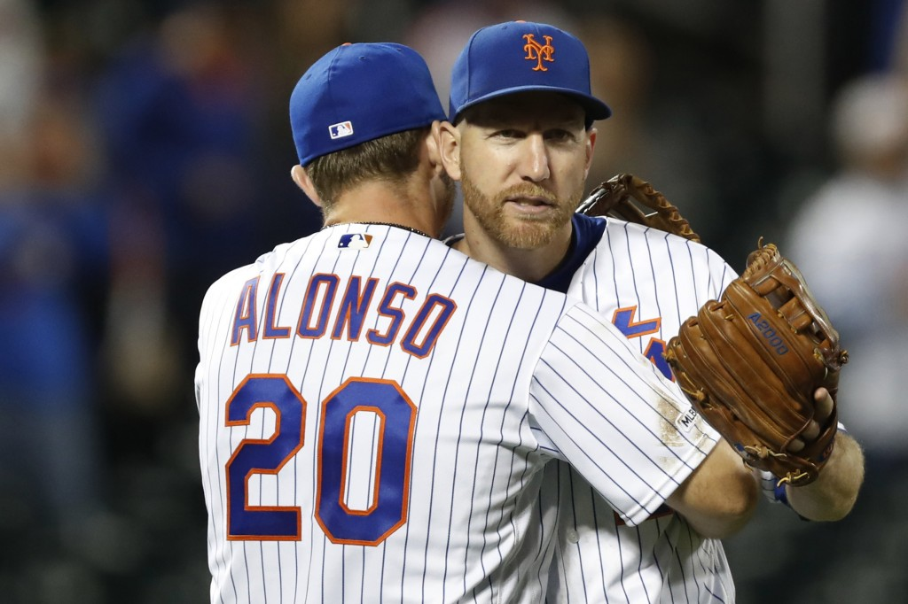 New York Mets first baseman Pete Alonso (20) embraces third baseman Todd Frazier after the Mets' 10-3 victory over the Miami Marlins in a baseball gam...