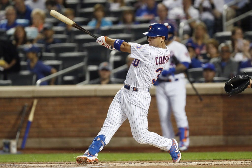 New York Mets' Michael Conforto hits a first-inning RBI double against the Miami Marlins during the first inning of a baseball game Wednesday, Sept. 2...