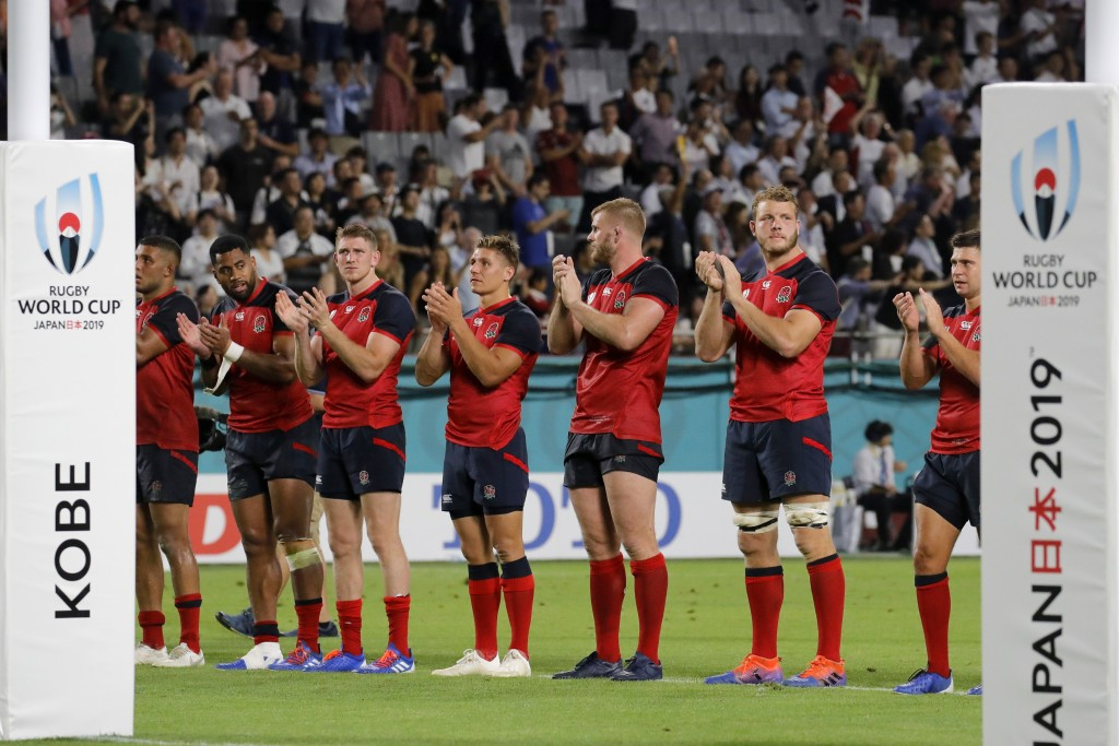 England players line up as they celebrate after the Rugby World Cup Pool C game at Kobe Misaki Stadium against the United States in Kobe, Japan, Thurs...