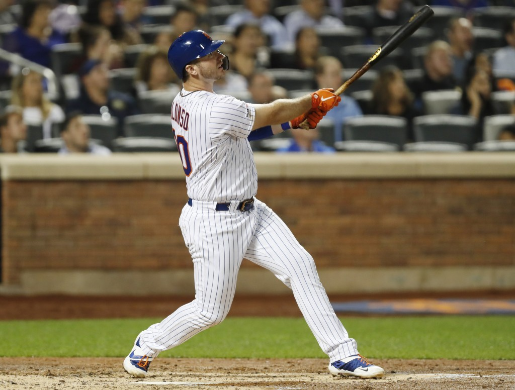 New York Mets' Pete Alonso (20) watches his three-run home run in the second inning of the team's baseball game against the Miami Marlins, Wednesday, ...