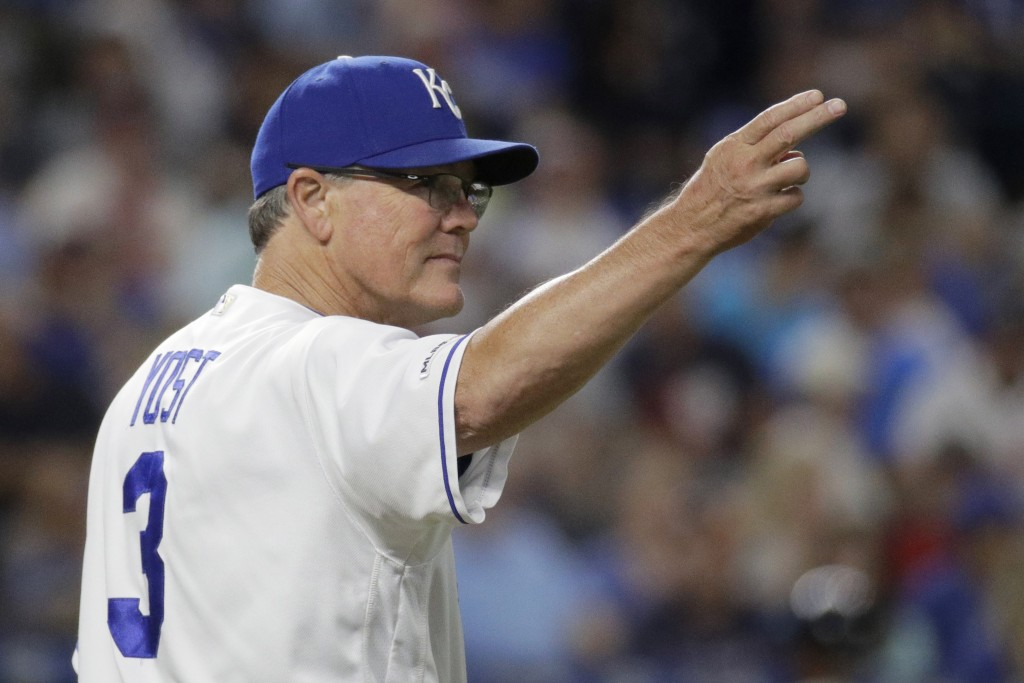 Kansas City Royals manager Ned Yost motions to the bullpen as he makes a pitching change during the fifth inning of the team's baseball game against t...