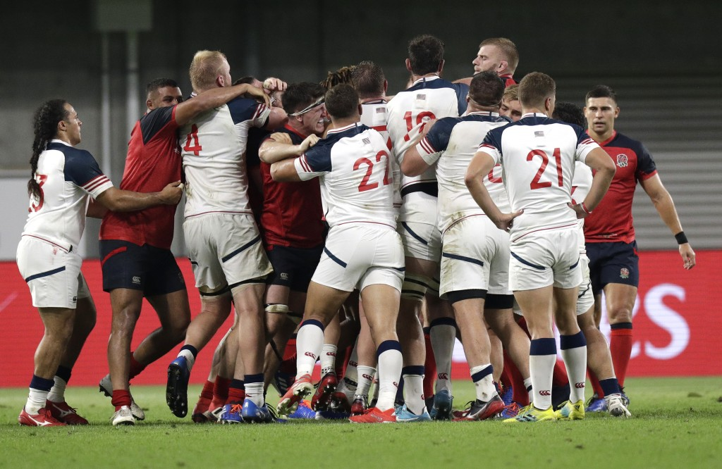 England and United States players tussle during their Rugby World Cup Pool C game at Kobe Misaki Stadium in Kobe, Japan, Thursday, Sept. 26, 2019. (AP...