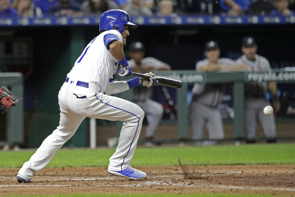 Kansas City Royals' Nicky Lopez hits an RBI bunt single during the fourth inning of the team's baseball game against the Atlanta Braves on Wednesday, ...